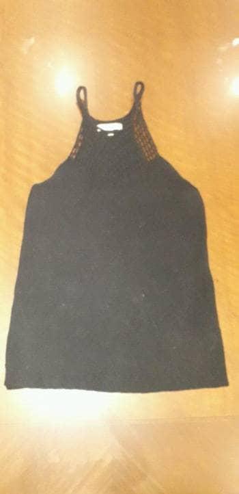 Camisa negra estilo red en el pecho